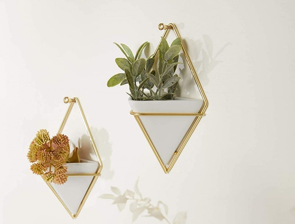 Two white and gold triangular hanging planters