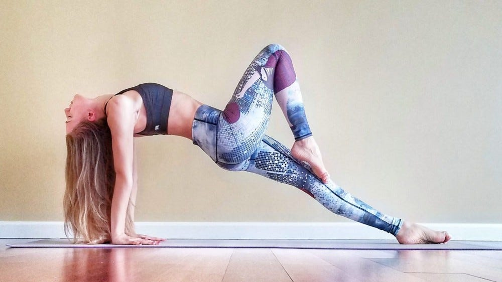 woman doing upward plank