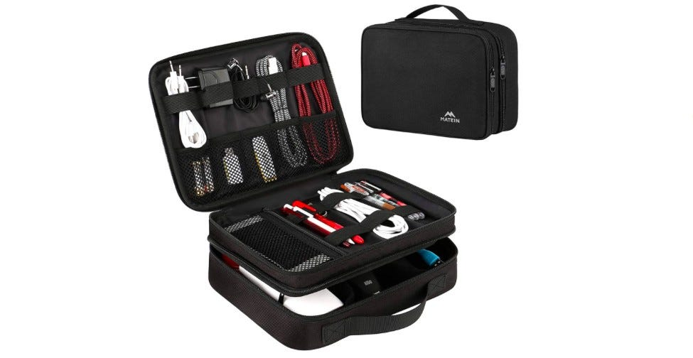 Black double-layer electronic organizer with cables and camera accessories inside