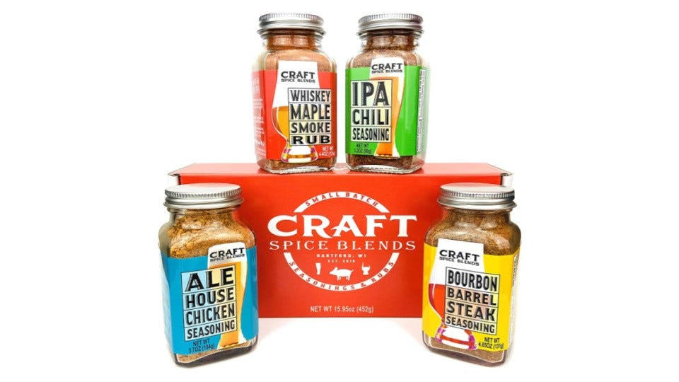 Four small jars of CRAFT Spice Blends presented with a red packaging gift box set on a white background.