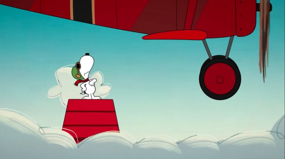 Snoopy the beagle rides on top of his red dog house.
