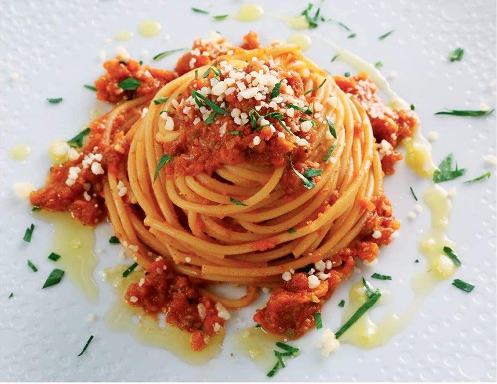 Serving of spaghetti with red sauce.