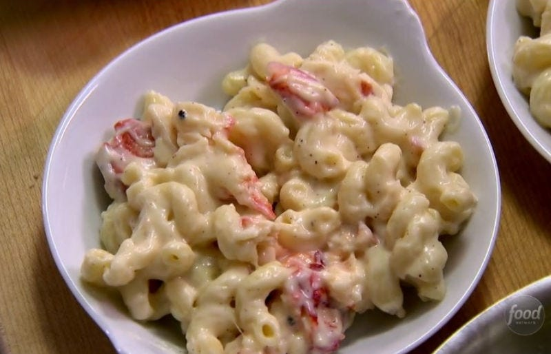 A bowl of creamy lobster mac and cheese.