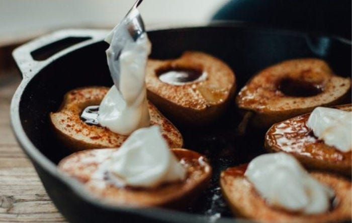 A few maple cinnamon pears with yogurt being added it them