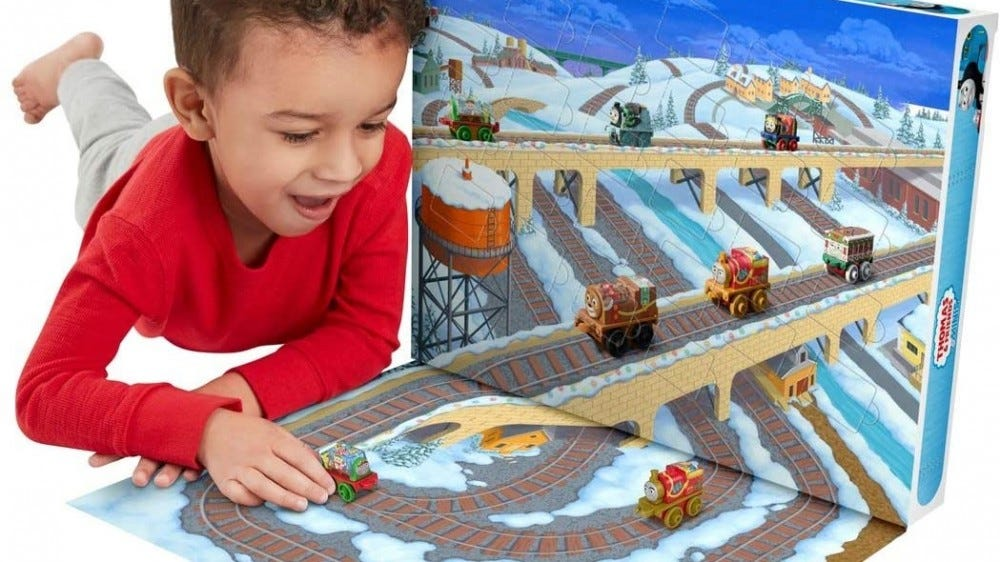 A little boy playing with the Thomas and Friends Advent Calendar.