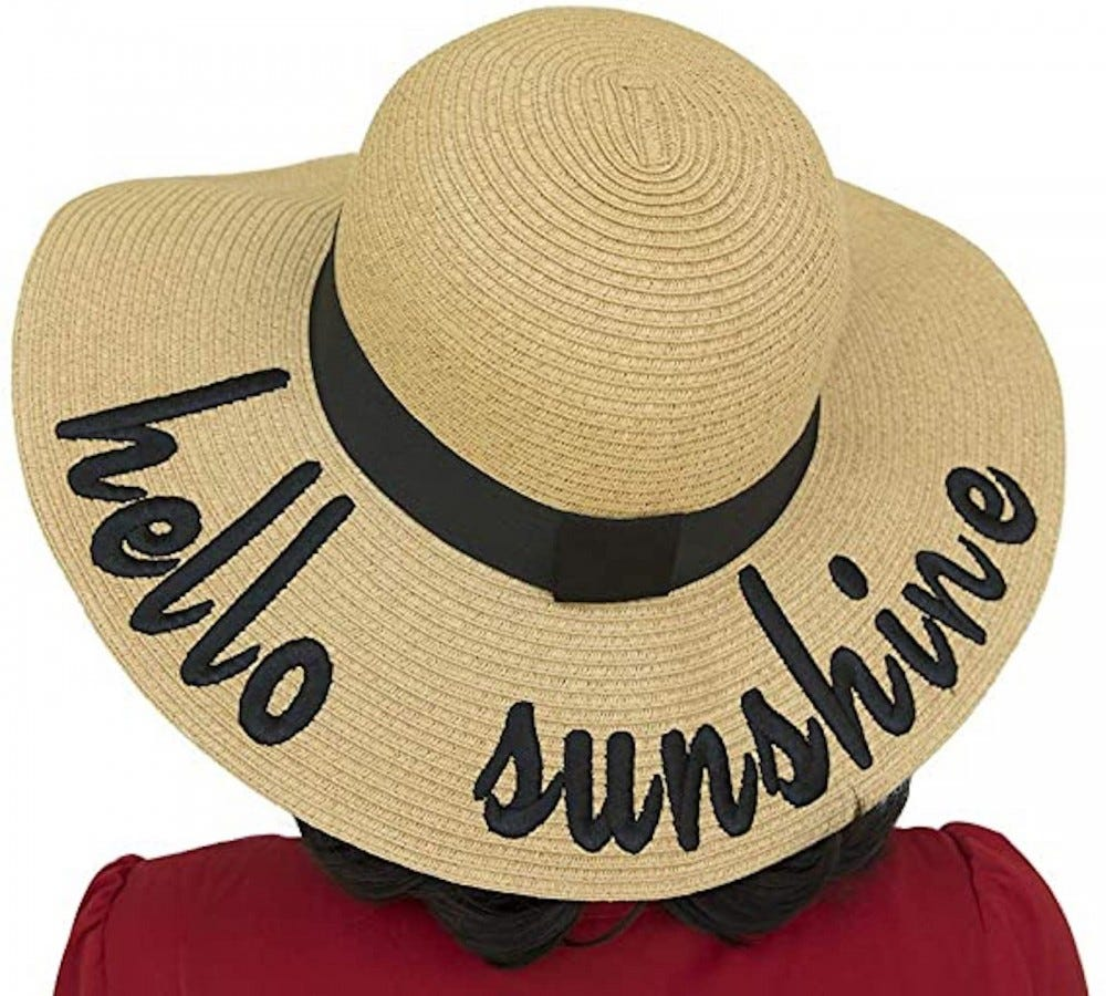 """Straw hat with """"hello sunshine"""" stitched in black script along the brim"""
