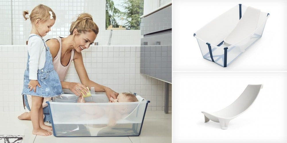 A mom bathing a baby in the Stokke Flexi Bath while a little girl watches.