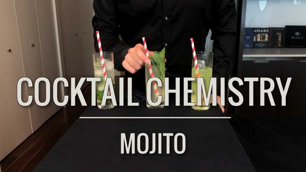 A mixologist showing off the results of three different ways to prepare a mojito cocktail.