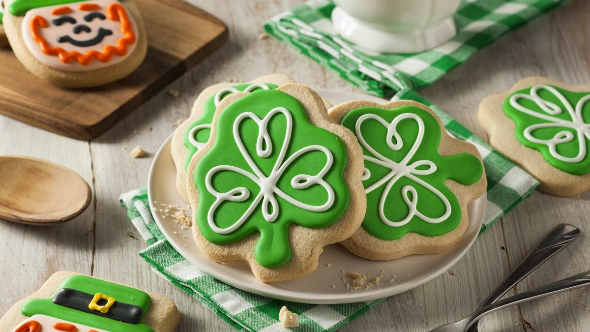 A plate of Shamrock cookies with green frosting.