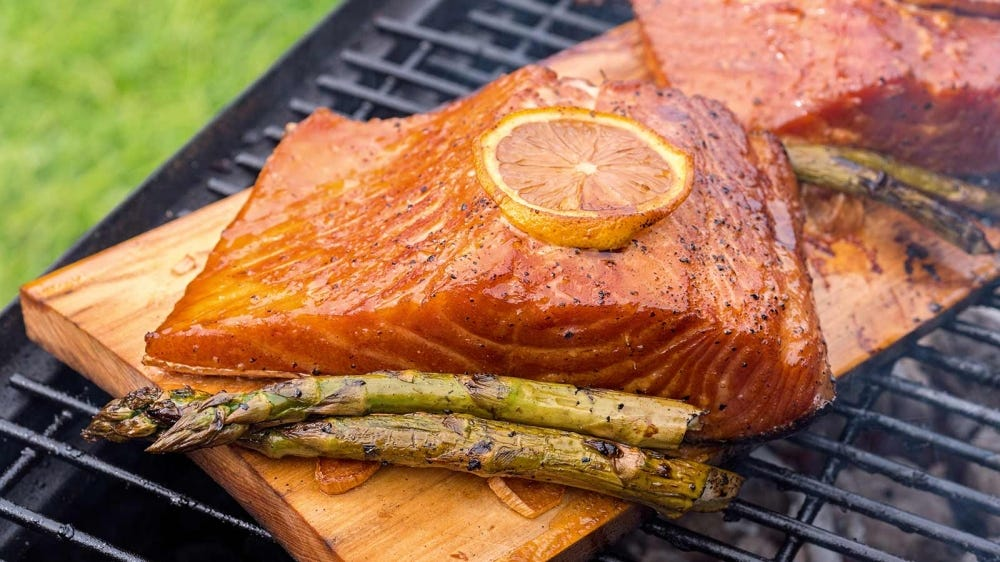 Salmon and asparagus on a grilling plank.