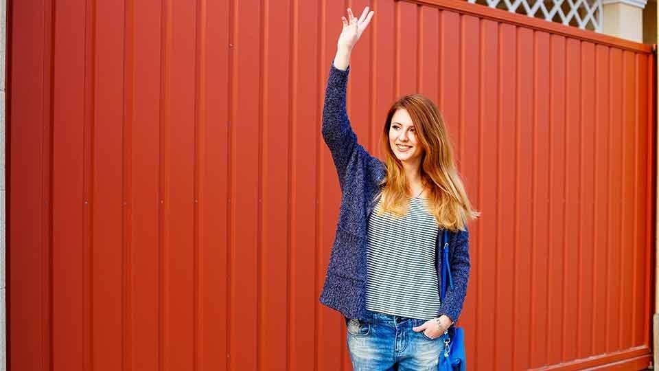 Woman waving goodbye.