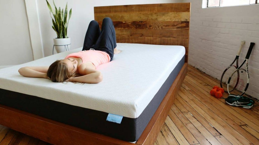 A woman laying on a Bear mattress.