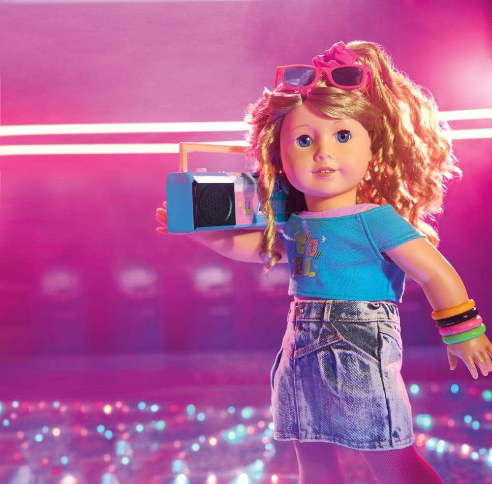 The Courtney American Girl doll holding a boom box.