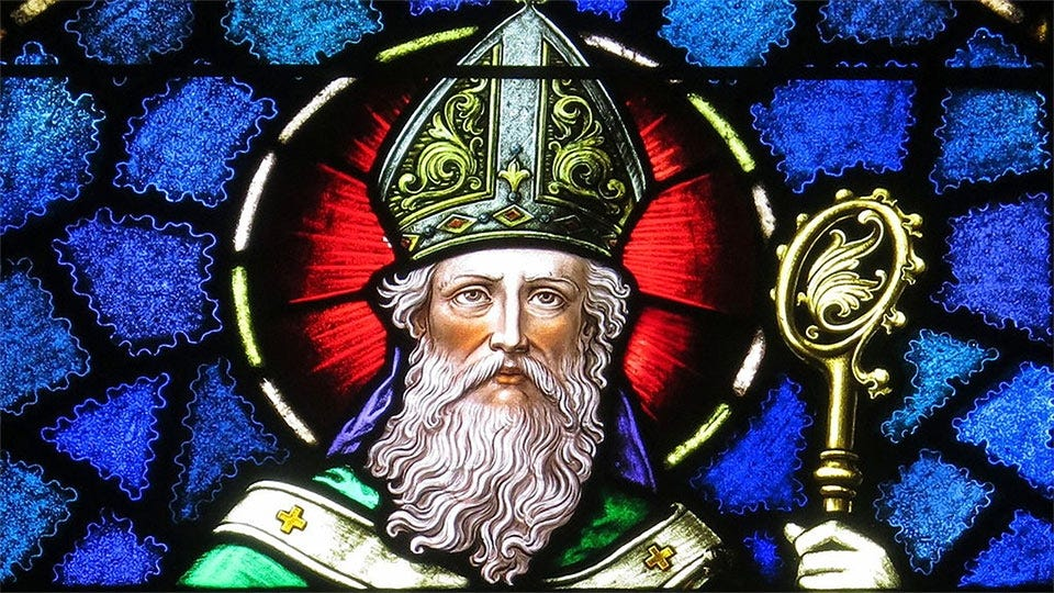 Stained glass window rendering of St. Patrick.