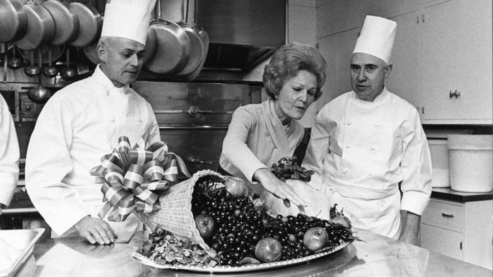 Pat Nixon consulting with the White House chefs.