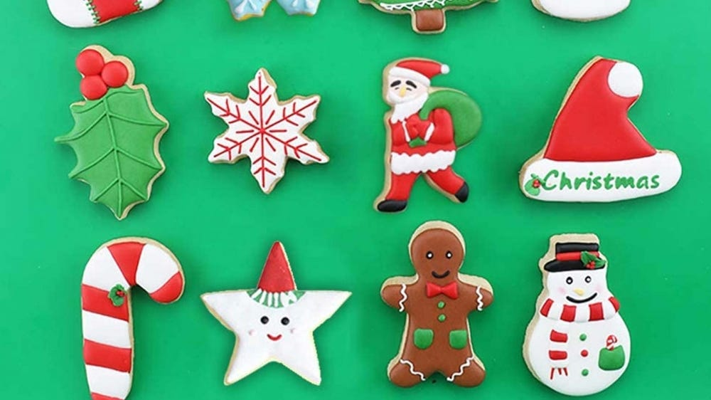 Decorated snowflake, holly, Santa Claus, gingerbread man, snowman, star, and candy cane sugar cookies.