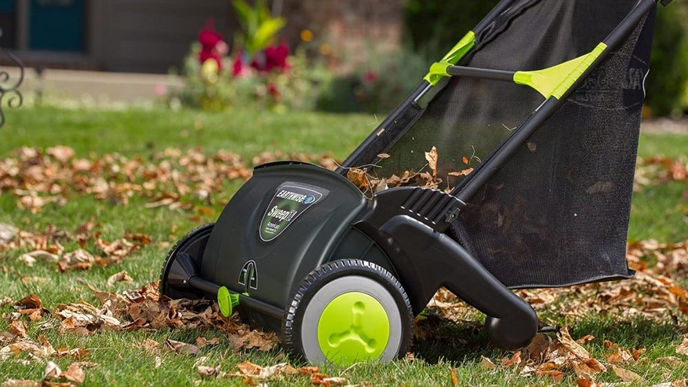 An Earthwise Lawn Sweeper on a lawn.
