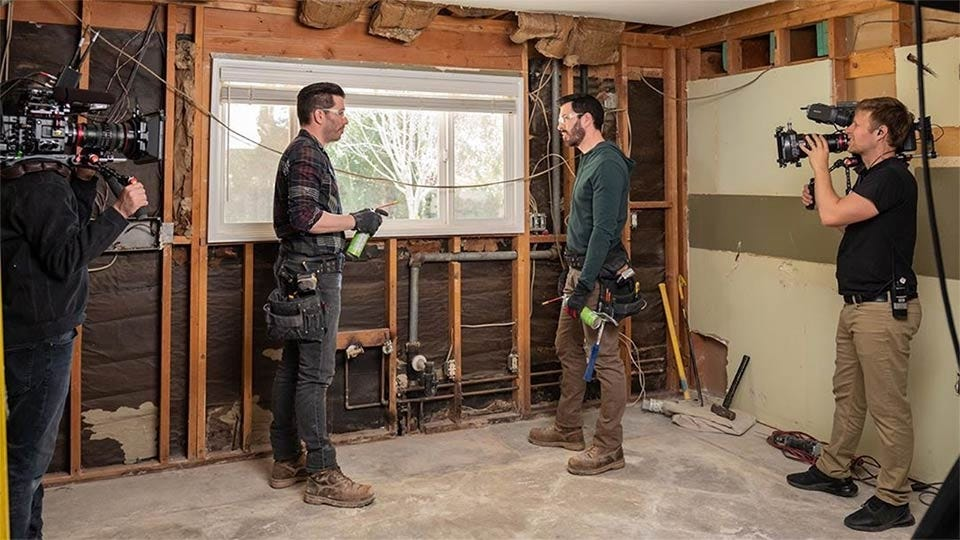 Drew Scott on Property Brothers in a freshly gutted kitchen.