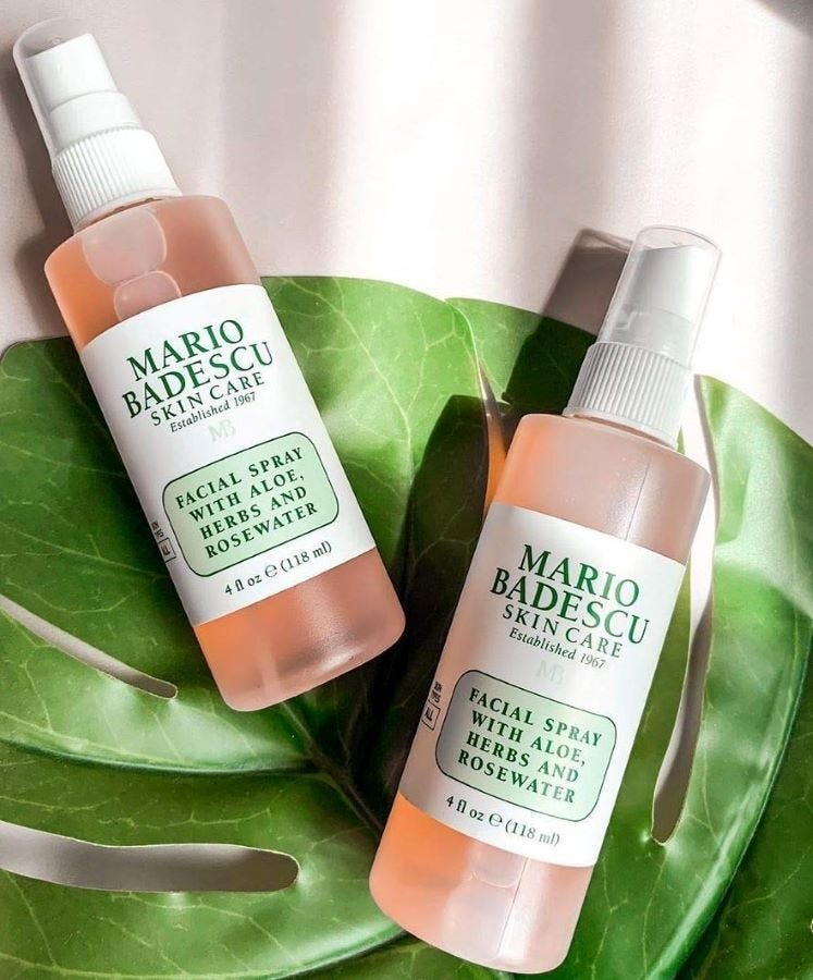 Two spray bottles of Mario Badescu Facial Spray with Aloe, Herbs and Rosewater.