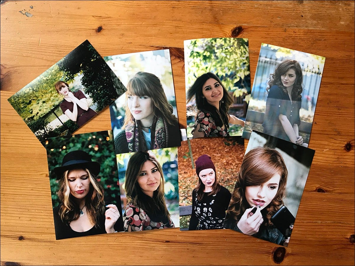 Printed photos spread out on a table