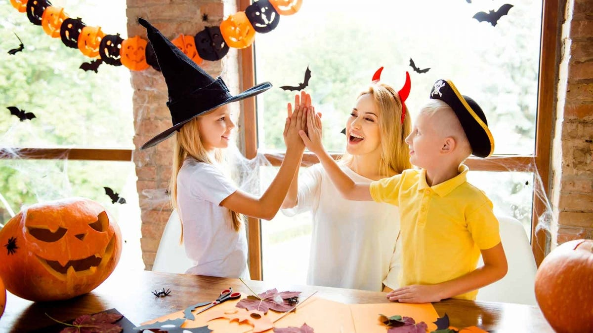 mom working on Halloween crafts with her two children