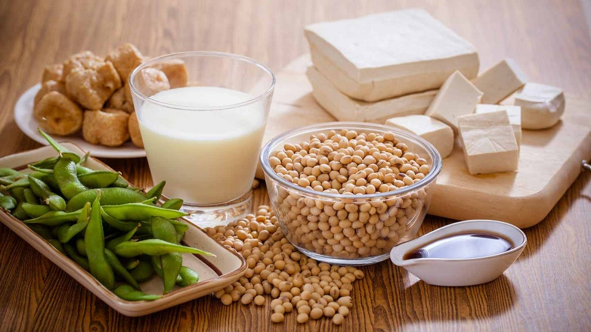 a table ladden with examples of the different kinds of products soy is found in