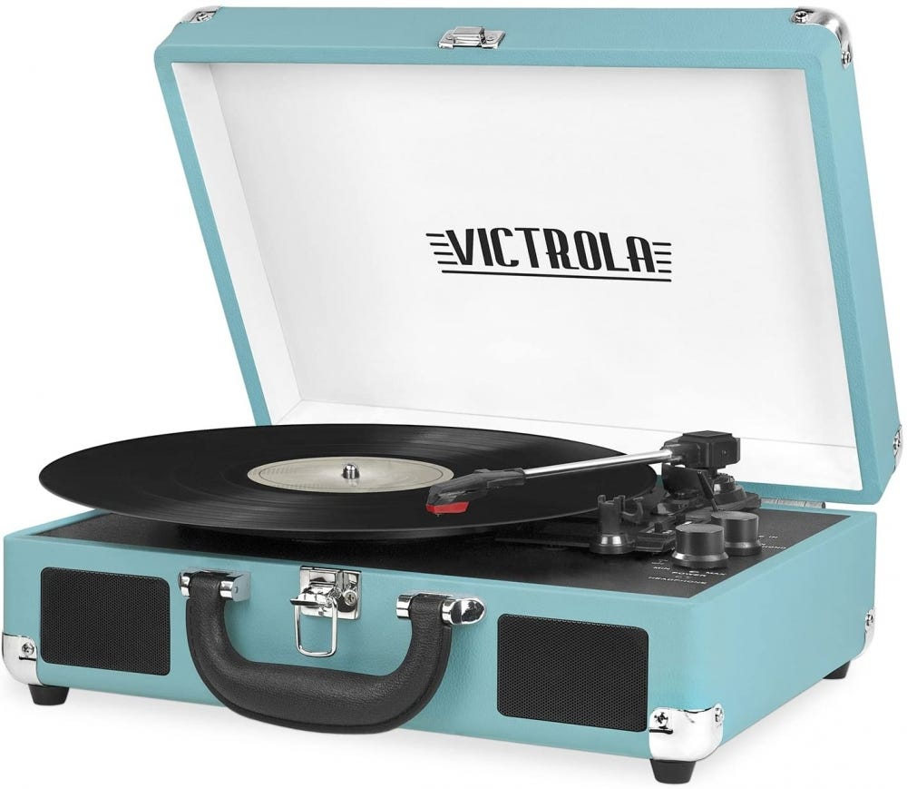 Light blue record player in a suitcase design, with a record on the table