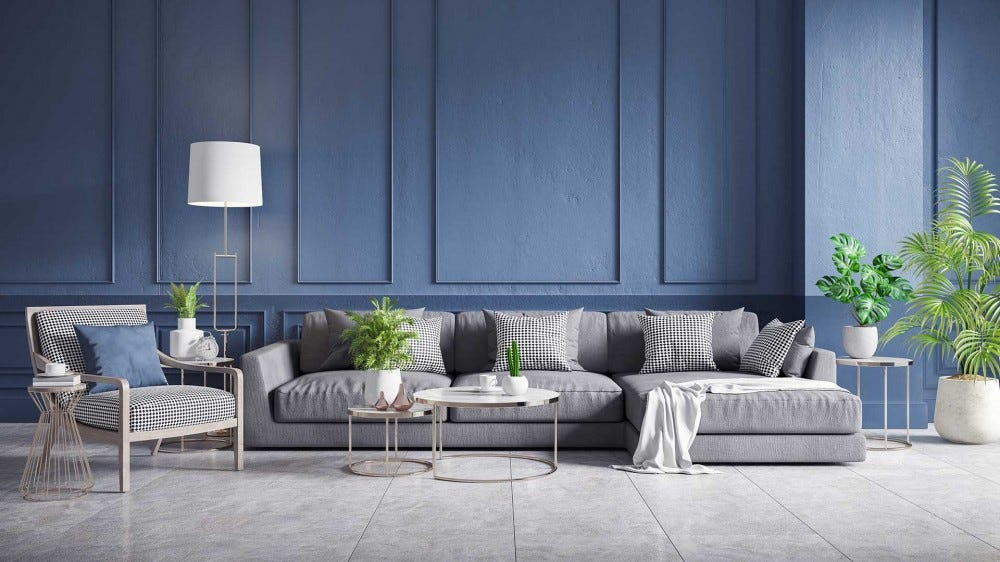 A living room with cool and soothing blue walls.