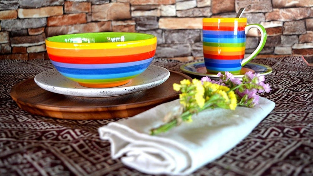 Rainbow bowl and cup on a table.