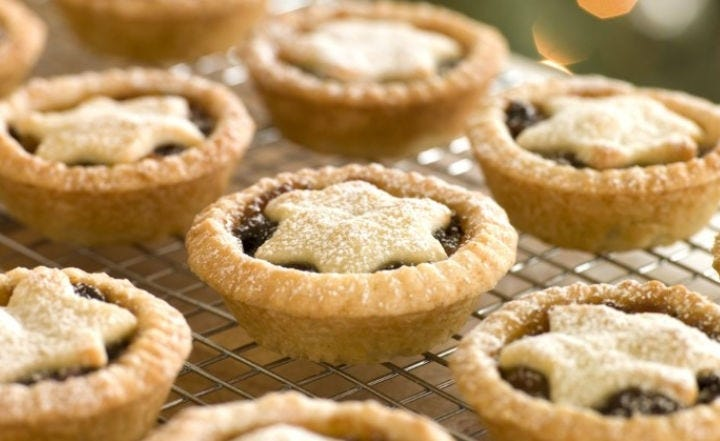 Mini Traditional Mince Pies sitting on a cooling rack.