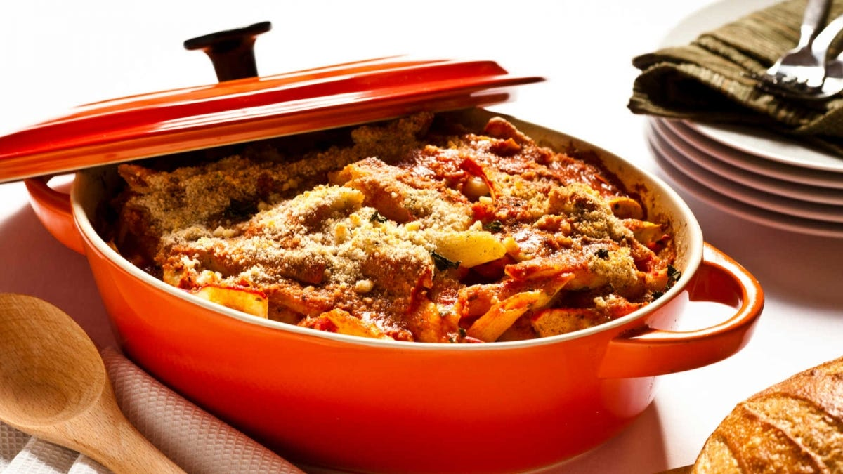 a one pot dutch oven meal in a red glazed dutch oven