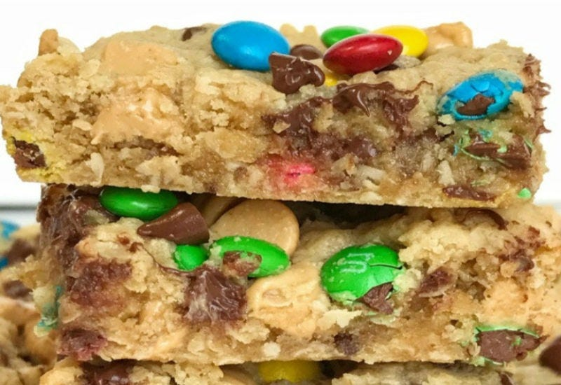 Two chewy pieces of monster cookie bars.