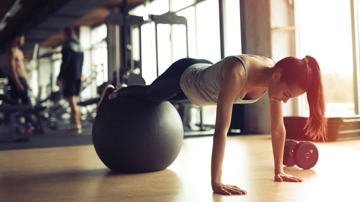 woman doing a higher intensity pushup using an exercise ball
