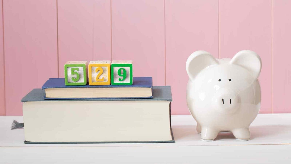 Saving for the costs of education with 529 plan artwork with piggy bank standing alongside stacked textbooks