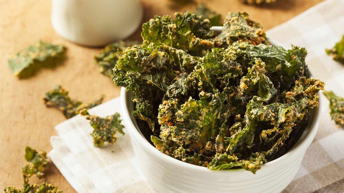 A white bowl full of kale.
