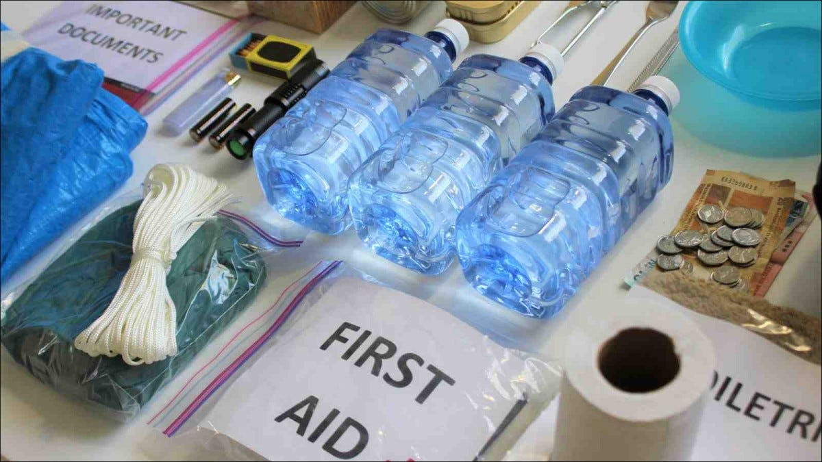 disaster supply kit items laid out on table