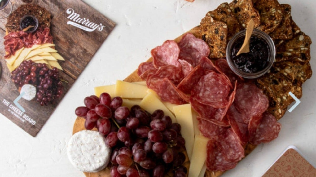 An example of the cheese, crackers, and extras with a Murray's cheese board box.