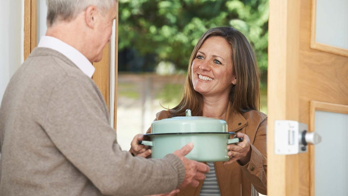 woman bringing a dish to pass at the holidays