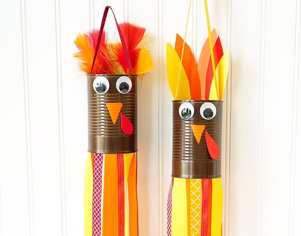 Tin cans and paper crafted into a turkey-themed wind sock