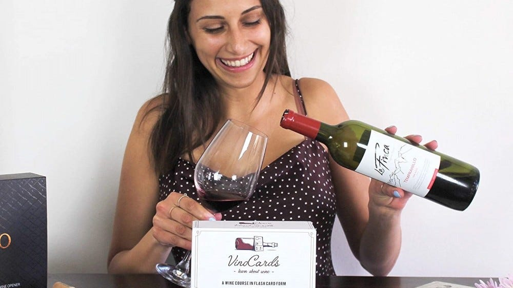 Woman enjoying wine with her Vino Cards.