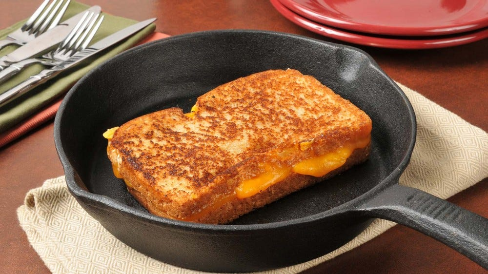 A grilled cheese sandwich in a cast iron skillet.