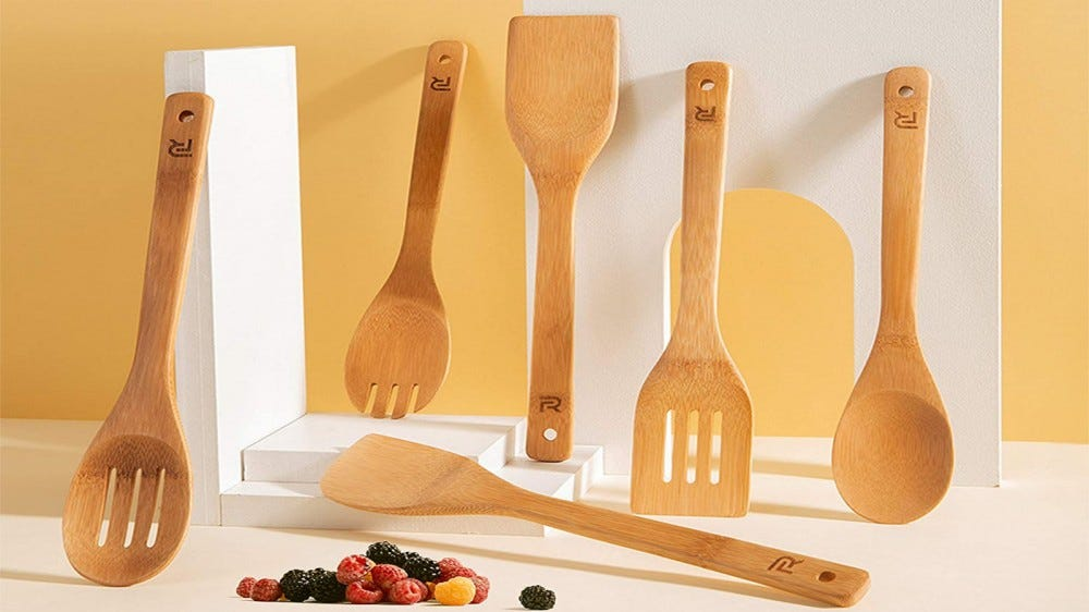 A set of 6 bamboo cookware with fresh berries on the front.