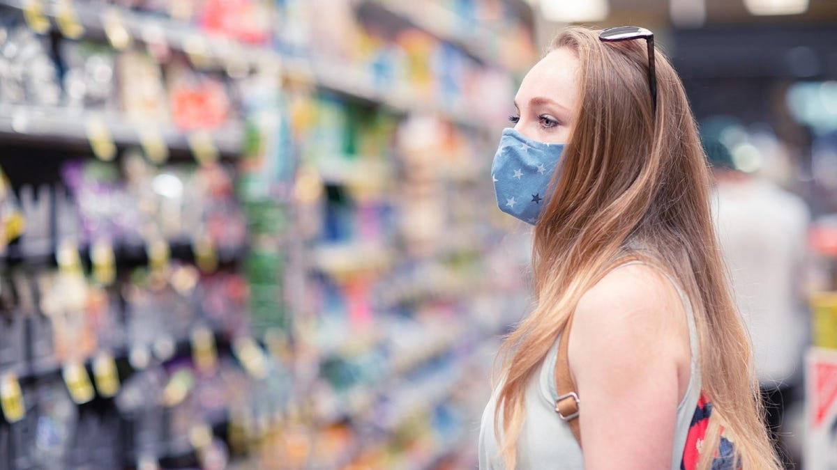 Woman wearing a cloth mask while shopping in a store.
