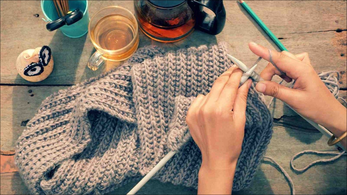 woman hand knitting from yarn
