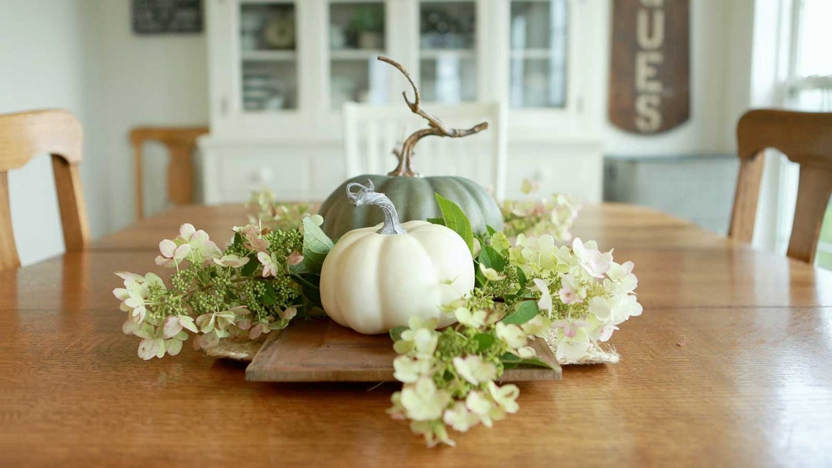 beautiful pumpkin centerpiece on a wooden table in a soft lit room