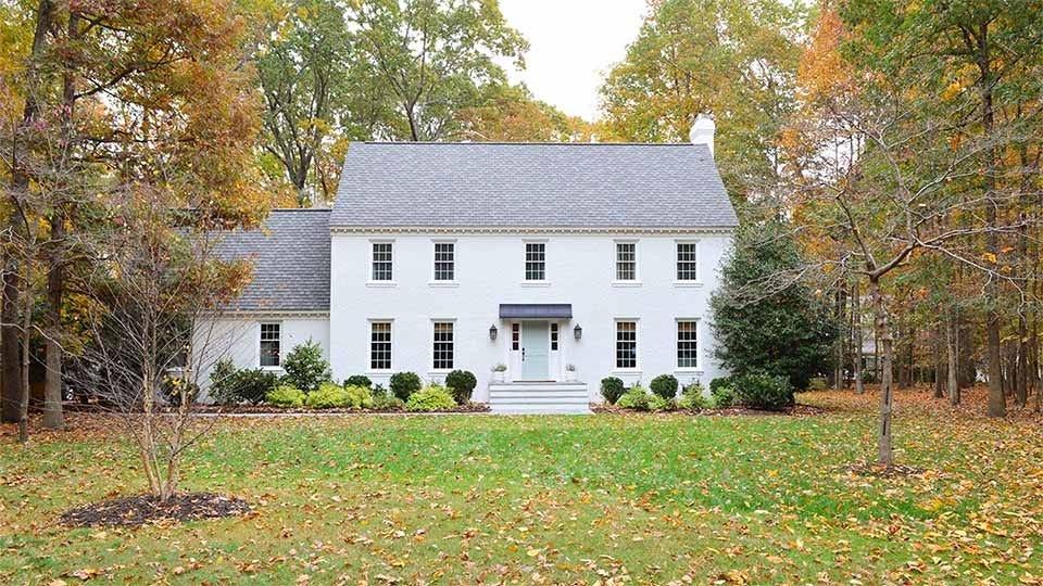 a beautiful brick house painted white
