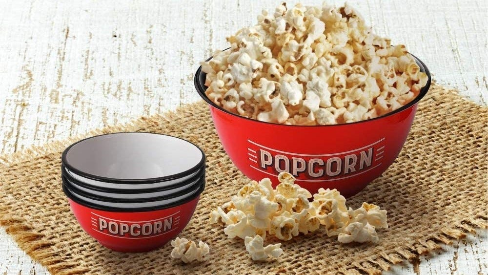 Serving bowl of popcorn next to single-serve dishes.