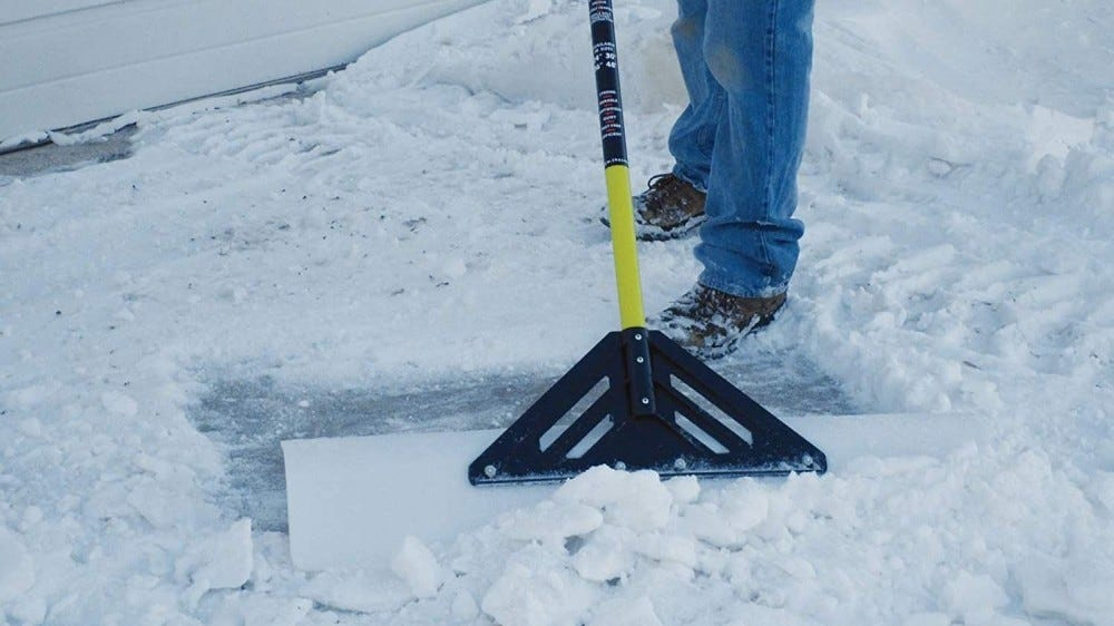 Snow blade used for clearing snow.