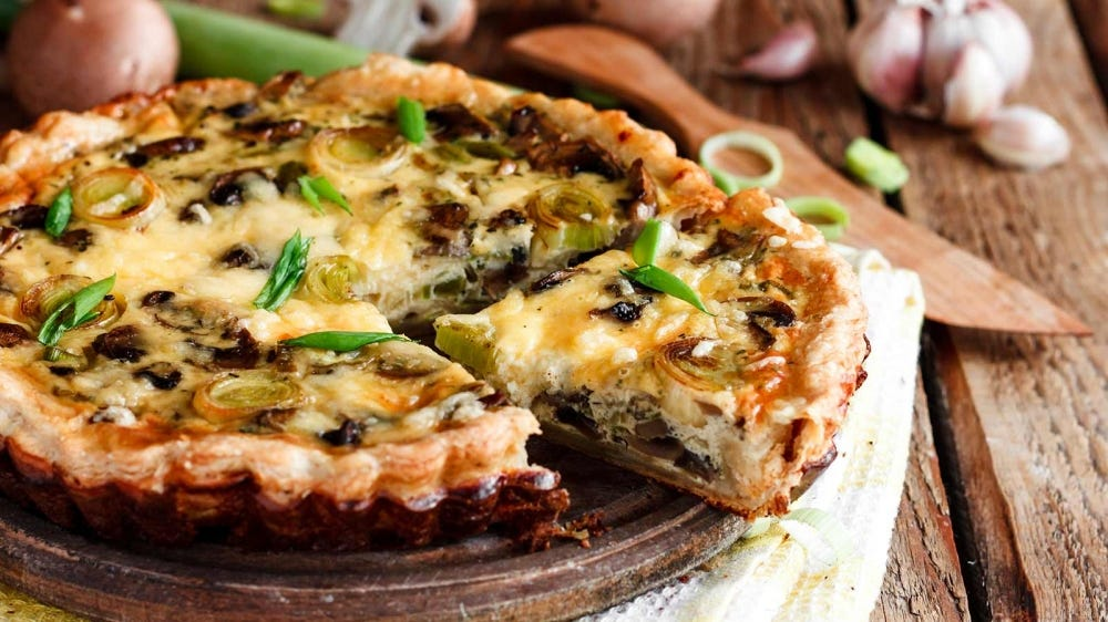 A quiche loaded with mushrooms.