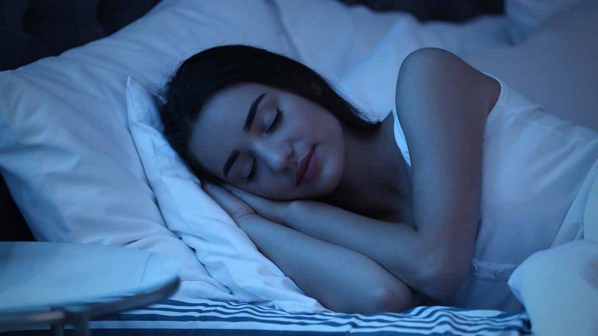 Woman sleeping peacefully in the middle of the night
